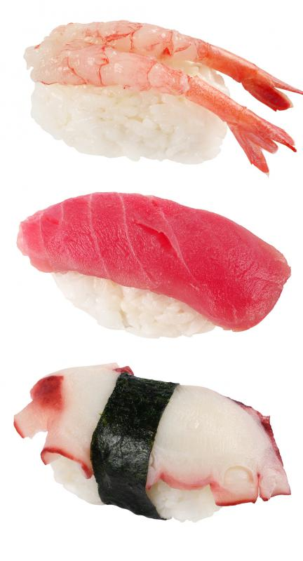 Nigiri sushi assortment, with a bluefin tuna piece in the middle.