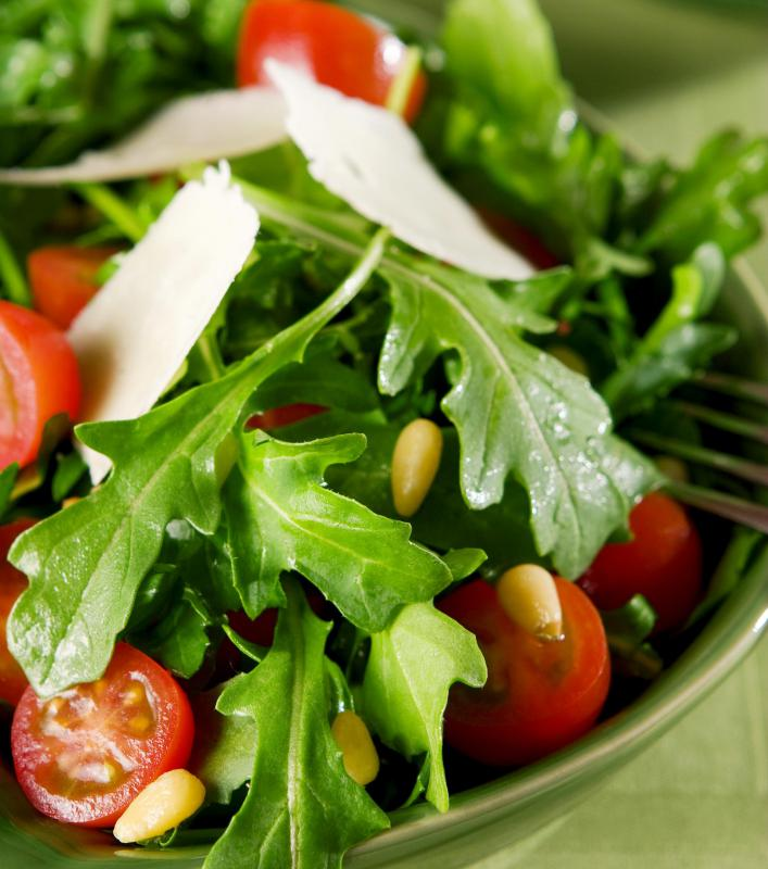 A salad containing cherry tomatoes, which are toxic to pets.