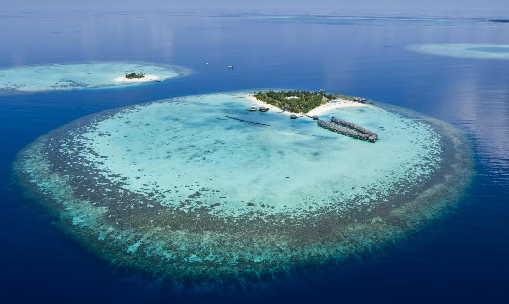 An atoll is a ring-shaped coral reef that surrounds a central lagoon.
