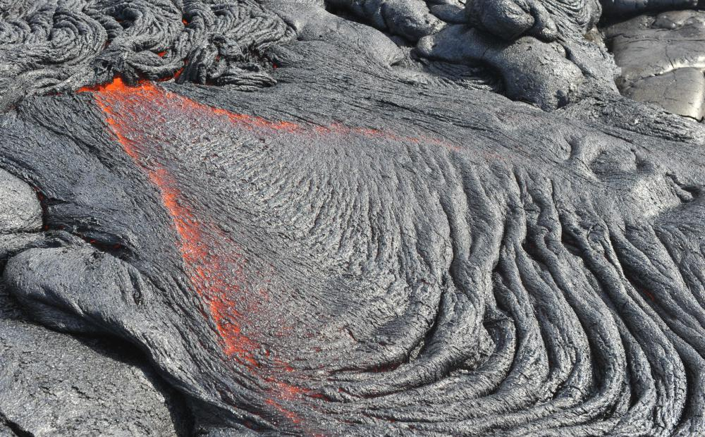 Volcanic craters are typically formed by the gradual build-up of lava flows.