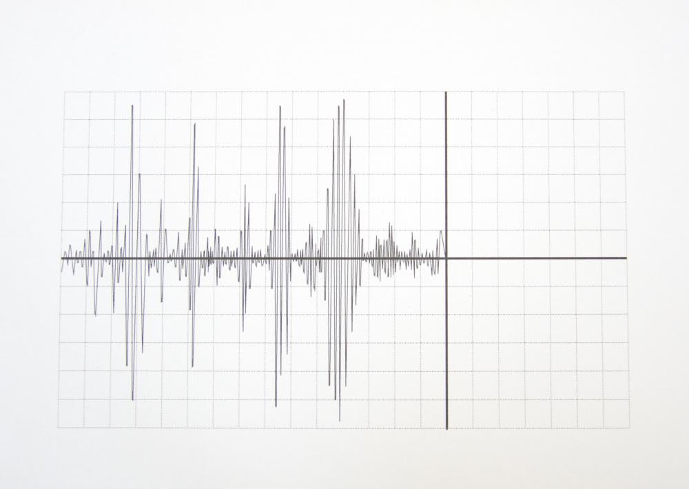 A seismograph measures and records ground motion from an earthquake in a series of lines on a graph.