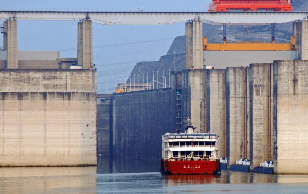 A ship going through a lock at the Three Gorges Dam, the world's largest hydroelectric dam, a source of renewable energy.